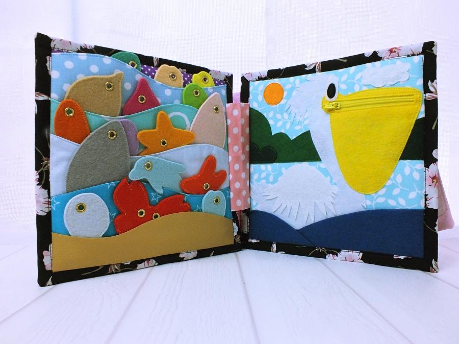 Memancing di buku bayi dan berkenalan dengan burung pelikan